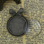 Round Antique Bronze Bow Brooch With Glass Cabochon Setting
